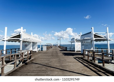 Detail view of the Woody Point Jetty, a popular recreational fishing spot in the Redcliffe Peninsula, Queensland, Australia