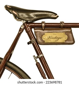 Detail of a vintage bicycle with leather saddle and bag isolated on a white background