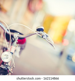 Detail of a Vintage Bike HandleBar with a Colorful Background Bokeh