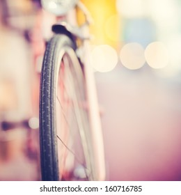 Detail of a Vintage Bike Tire with Colorful Background Bokeh (shallow DOF)