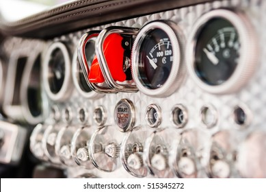 Detail of vintage racing cars cockpit with aluminum parts and designd by plane details