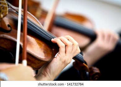 Detail of violin being played by a musician