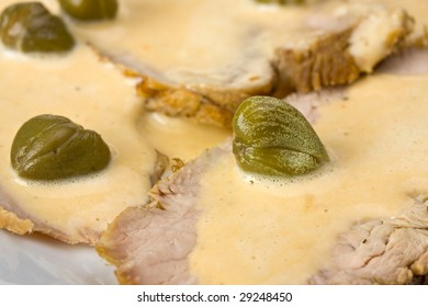 detail of vitello tonnato on a plate