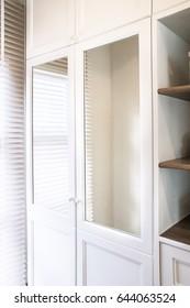 Detail of walk in closet with wardrobe.