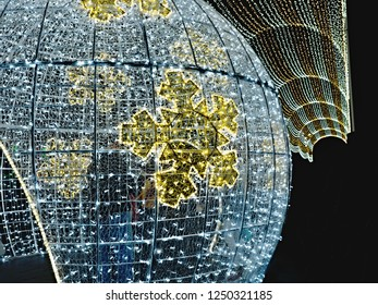 Detail of a walkable Christmas ball, a great decoration in downtown Santa Cruz de Tenerife in the Canary Islands. Above it the light roof of the path behind it.