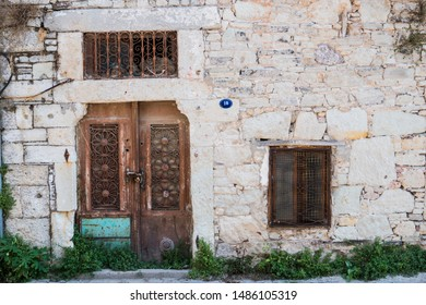 Detail of the wall of an historical abandoned with an iron gate  FOÇA , İZMİR , TURKEY - 08 - 04 - 2019