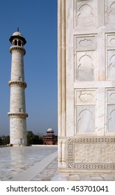 Detail of a wall and minaret of the Taj Mahal, built in white marble city of Agra , Utta Pradesh , India