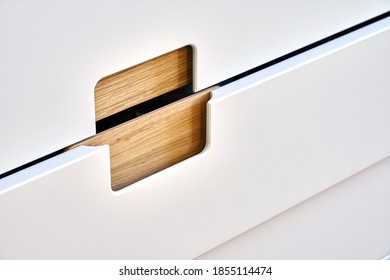 Detail of the wardrobe close-up. Modern wooden wardrobe with flat finger pull wardrobe doors. Oak veneered plywood cabinets with light gray painted cabinet doors. Modern furniture - Shutterstock ID 1855114474