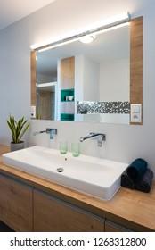 Detail of washbasin in modern bathroom