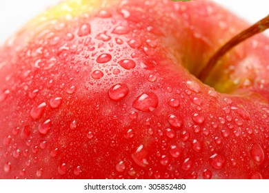 detail of washed red apple on white background