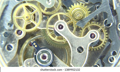 Detail of watch mechanism motion, different pieces but alike important