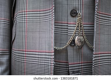 Detail Of A Watch On A Chain On A Smart Men's Waistcoat And Suit