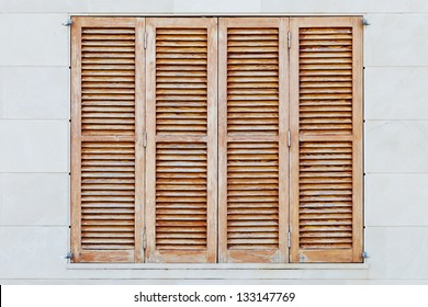 Detail of weathered brown shutters of a spanish house