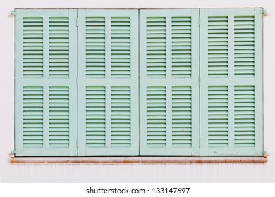 Detail of weathered green shutters of a spanish house