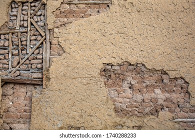 Detail from the weathered mud brick wall of an old house in Odun Pazari district of Eskisehir, Turkey.