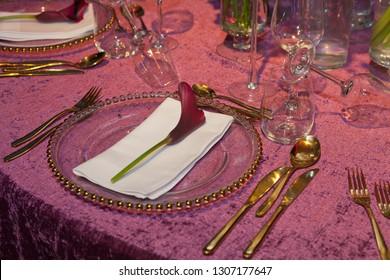 Detail of a wedding dinner in pink velvet