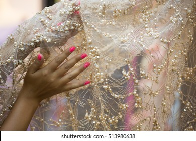 Detail of wedding dress , texture of the material for bride with embroidered flowers, shallow focus, composition