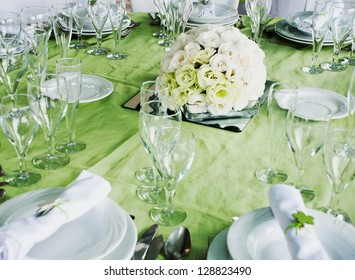 detail of a wedding table set for fine dining with estomas flowers arrangement