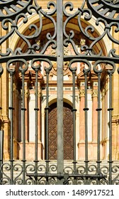 "Detail of the west iron cast gate of the Roman Catholic cathedral ""Santa Iglesia Catedral Basílica de la Encarnación"" in the city of Malaga in Andalusia in southern Spain of Renaissance architecture."