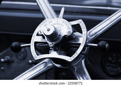 Detail of wheel of a vintage car with gear levers