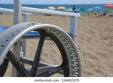 detail of a wheelchair with modified wheels to be able to go on the beach sand