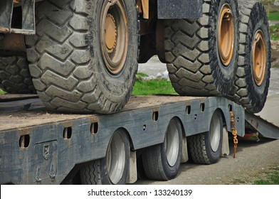 Detail of the wheels of a 30 ton dump truck loaded on a semi-trailer