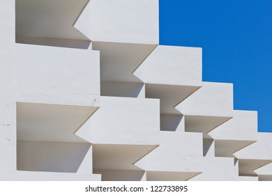 Detail of a white building in front of a blue sky