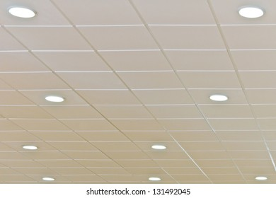 Detail of a white ceiling with integrated lightning