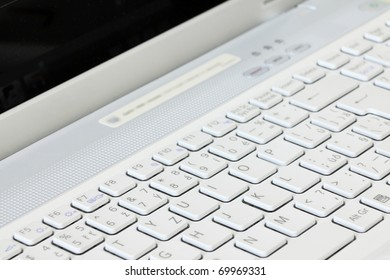 The detail of the white Key Board Laptop Computer