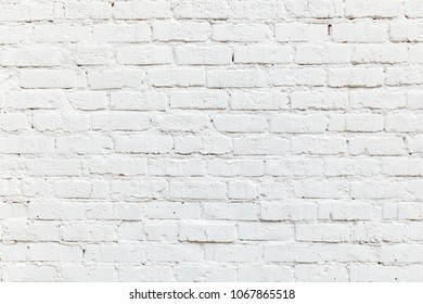 detail of white painted brick wall gives a harmonic background