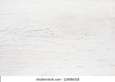 Detail of white painted and plastered wall.  Rough texture on wooden board.