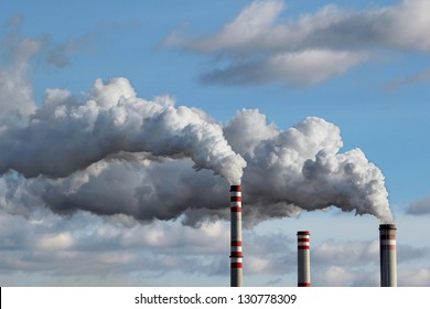detail of white smoke polluted sky