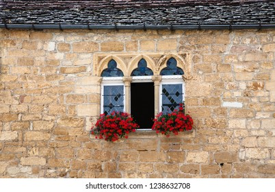 Detail of a window with flowers in the village of Domme. France