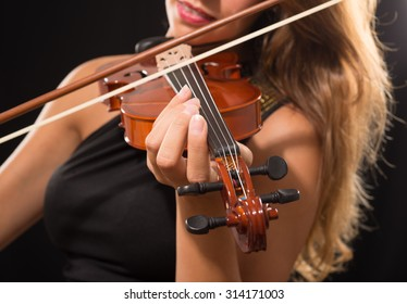 Detail of a woman playing her violin