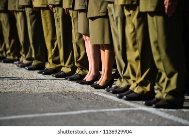 Detail with women in uniforms standing in formation during military ceremony