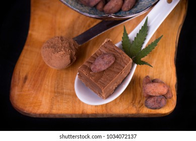 Detail of wood tray with Cannabis infused chocolate fudge - medical marijuana edibles concept