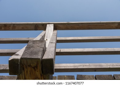 Detail of wooden observation deck in front of blue sky