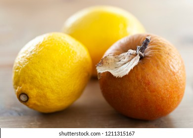 Detail of a Wrinkled apple and two lemons in autumn