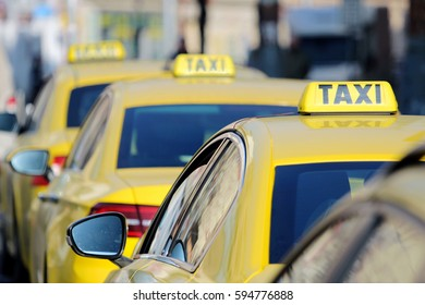 detail of yellow taxi cars on the street