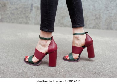 Detail of young fashion woman on the city street . High heel shoes .