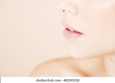 Detail of young woman's face showing mouth and chin