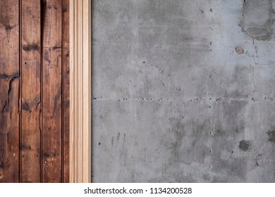 Detailed background texture of old and worn timber panels and cracked concrete