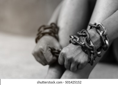 Detailed black and white image blur incredible feet chained.