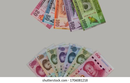 Detailed close up to the Chinese and Sri Lanka currency on white grey background. Fan of Sri Lanka rupees and China  Renminbi money. Specimen notes of Asian paper currency isolated fan.