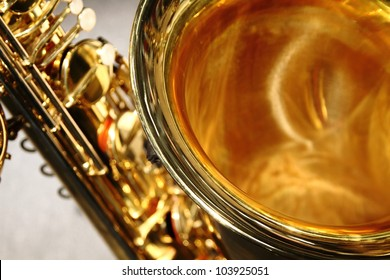 Detailed close up of saxophone bell with keys behind
