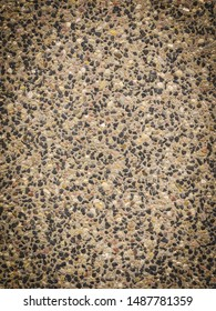 Detailed close up of texture pattern with brown black little stones and rocks. Abstract background concept.