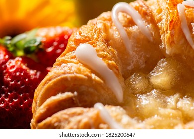 Detailed closeup macro photo of an Apple Danish Pastry, food background.