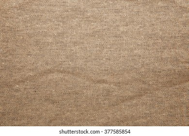 Detailed Closeup vintage old textured fabric burlap, rustic background in tan beige,brown, grey. Canvas Macro Pattern. Natural Light Linen Texture.