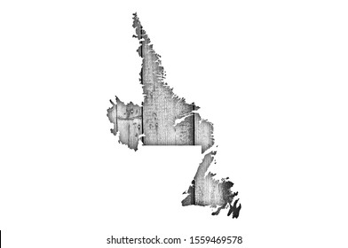 Detailed and colorful image of map of Newfoundland and Labrador on weathered wood