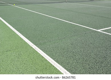 Detailed image of an asphalt tennis court